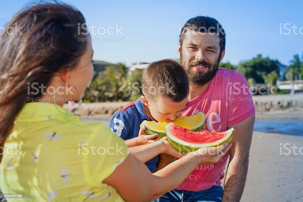 Beautiful happy family funny picnic on sand sea beach stock photo