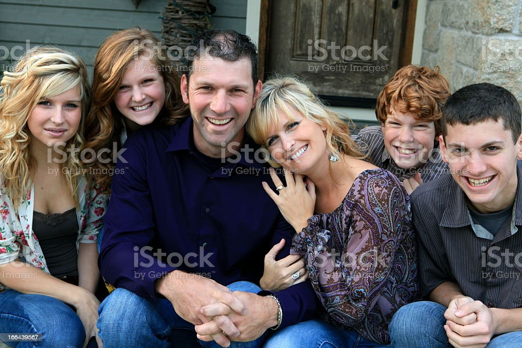 Beautiful happy family of six smiling at the camera stock photo