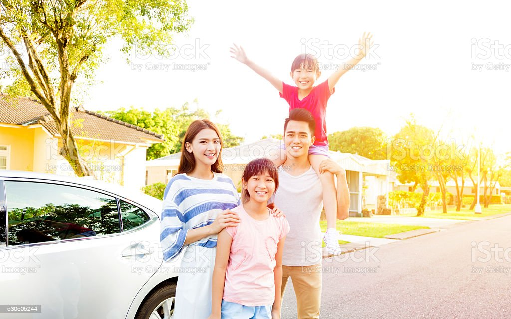 Beautiful happy family portrait  outside their  house stock photo