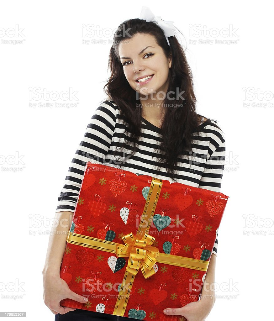Beautiful happy girl smiling and holding gift royalty-free stock photo