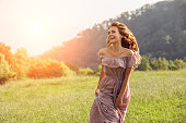 istock Beautiful happy girl walking by the field 1186044662