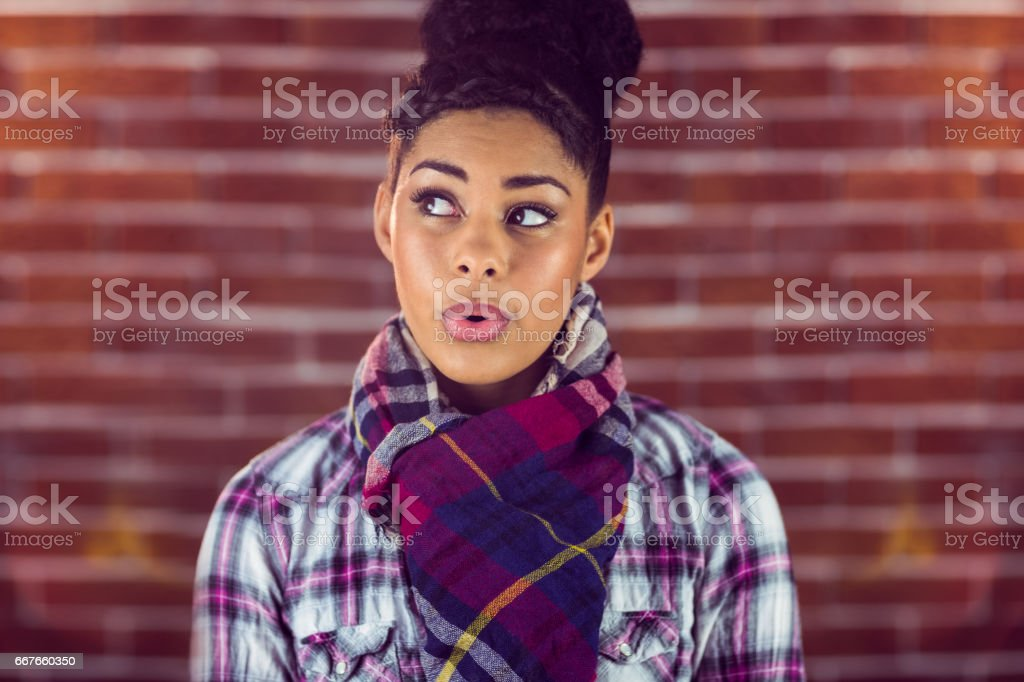 A beautiful happy hipster whistling stock photo