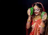 istock A beautiful happy Indian bride holding betel leaf 1175943875