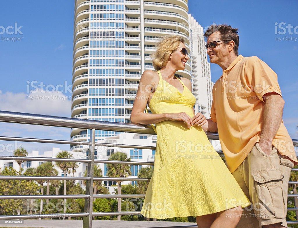 Beautiful Happy Mature Couple Talking on the Street royalty-free stock photo