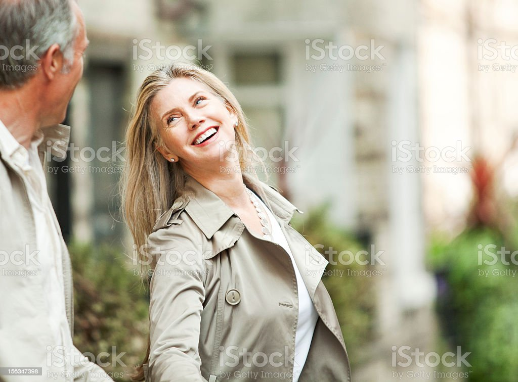 Beautiful happy mature woman looking at her husband stock photo