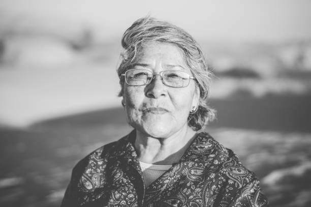 Beautiful happy Mexican grandmother enjoying her trip to the desert in Mexico Beautiful happy grandmother enjoying her trip to the desert of the dunes of bilba in Coahuila Mexico. coahuila state stock pictures, royalty-free photos & images