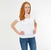 istock Beautiful happy red hair girl in white t-shirt isolated. Pretty smile red head woman in tshirt mock up, blank. 1219981487