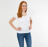 istock Beautiful happy red hair girl in white t-shirt isolated. Pretty smile red head woman in tshirt mock up, blank. 1223843850