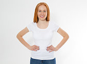 istock Beautiful happy red hair girl in white t-shirt isolated. Pretty smile red head woman in tshirt mock up, blank. 1245066651