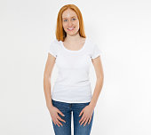 istock Beautiful happy red hair girl in white t-shirt isolated. Pretty smile red head woman in tshirt mock up, blank. 1245066653
