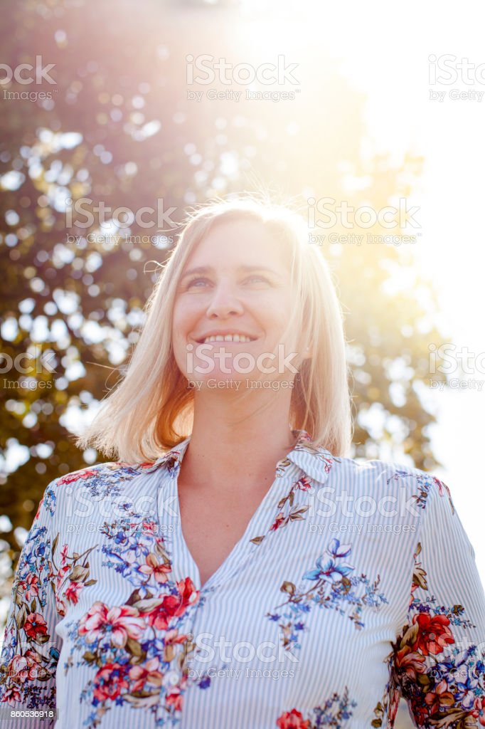 beautiful Happy satisfied Woman with sunflair stock photo