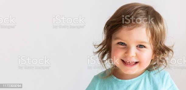 Beautiful happy toddler child girl smiling portrait neutral picture id1172303294?b=1&k=6&m=1172303294&s=612x612&h=q4urizb4b80qhlwj6ki4f4omrm0bgapguczqperdyzs=
