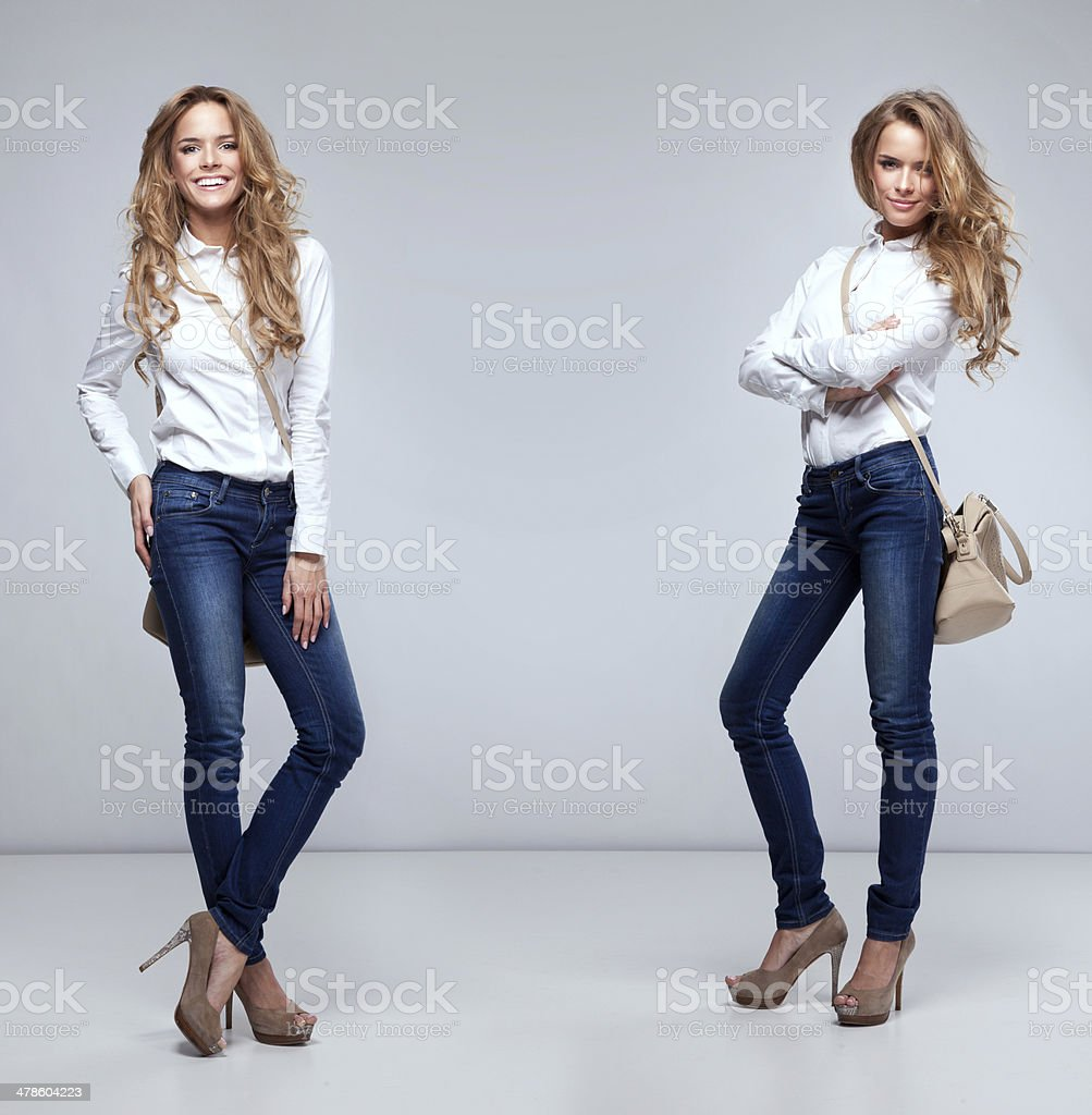 Beautiful happy twins on a grey background smiling. stock photo