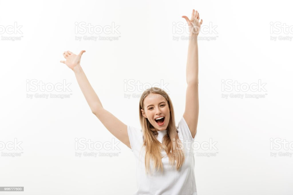 Beautiful happy woman at celebration. Birthday or New Year eve celebrating concept. Isolated over white background. stock photo