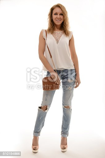 509923232istockphoto Beautiful happy woman holding a bag 510154866