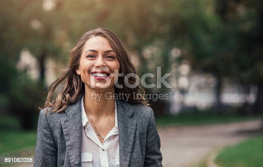 Portrait of a beautiful happy woman outdoors.