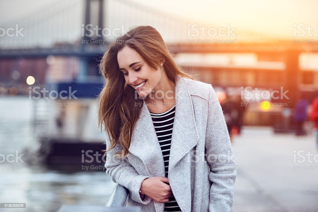 Beautiful happy woman walking and looking down stock photo