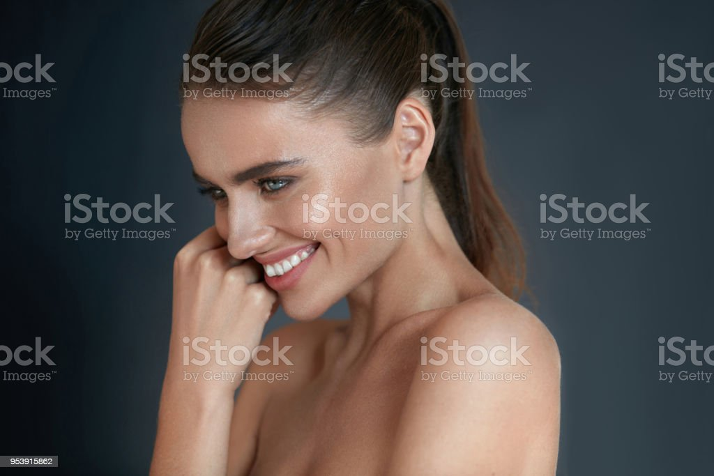 Beautiful Happy Woman With Fresh Makeup On Beauty Face. Skincare stock photo
