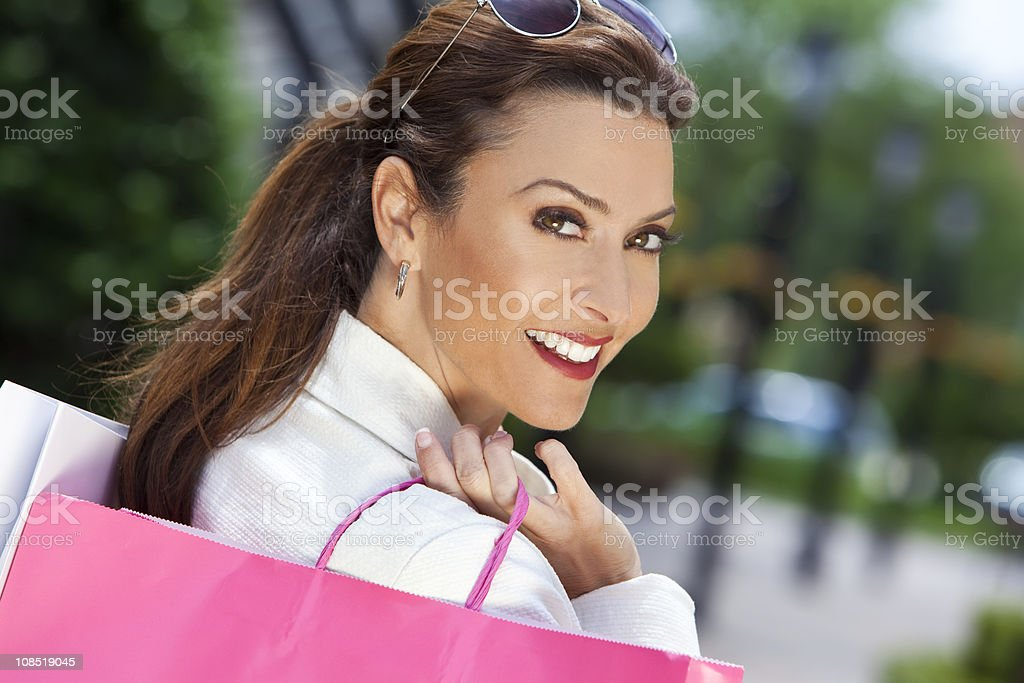 Beautiful Happy Woman With Pink and White Shopping Bags royalty-free stock photo