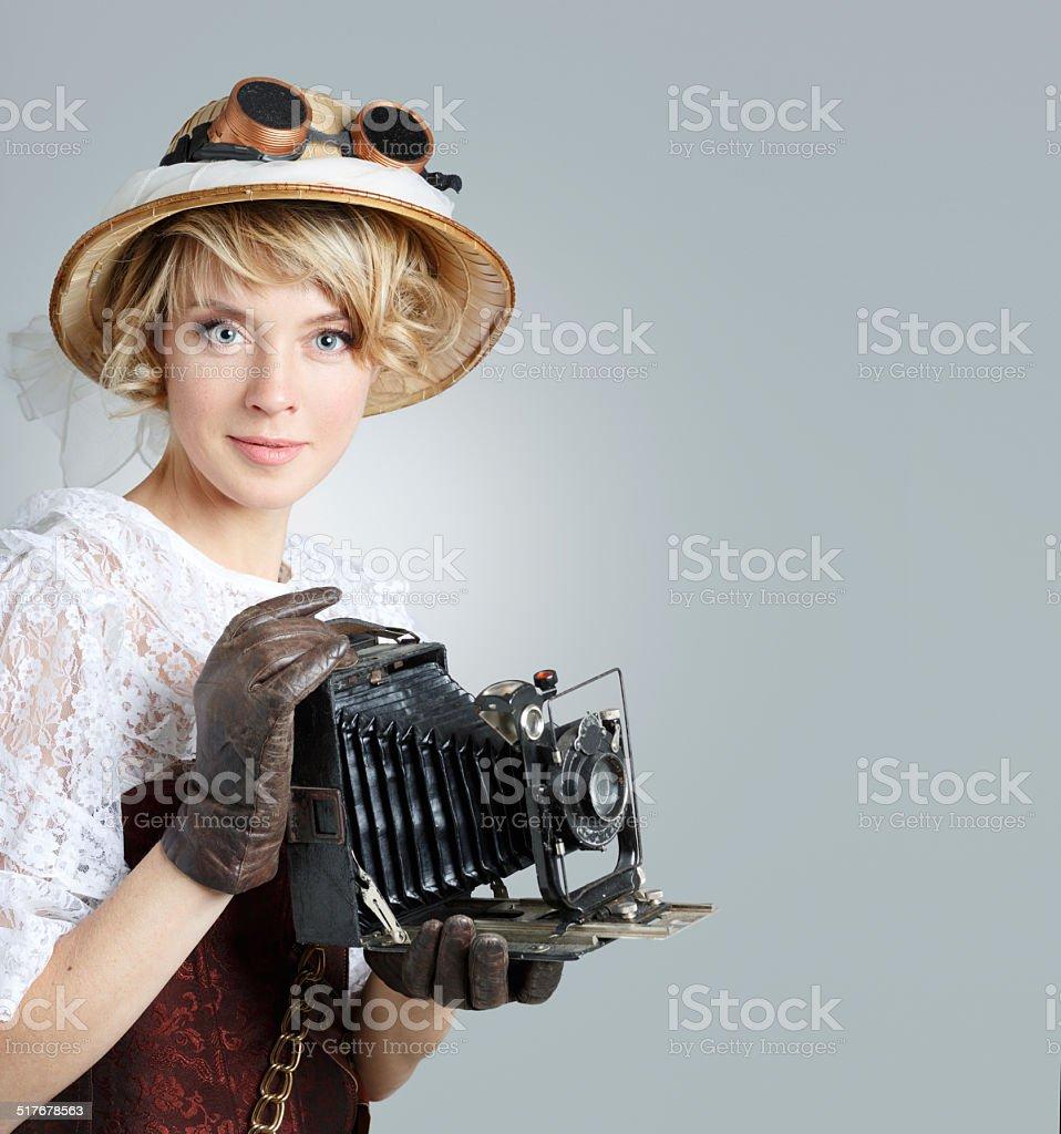 Beautiful happy woman with retro camera. stock photo