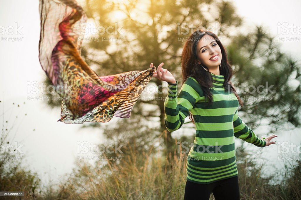 Beautiful happy young woman flying scarf in nature. royalty-free stock photo