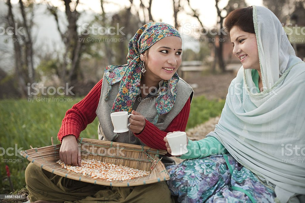 Beautiful happy young women enjoying tea royalty-free stock photo