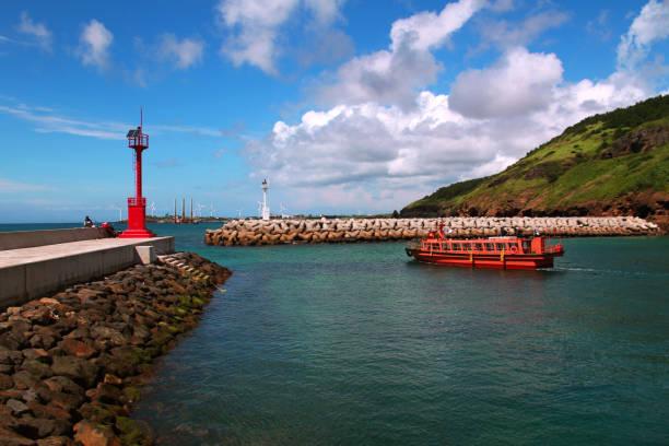 beautiful harbor and cruise ship of jeju, korea. - jeju island stock photos and pictures