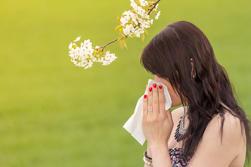istock Beautiful hayfever girl wiping her nose in spring nature 466728186