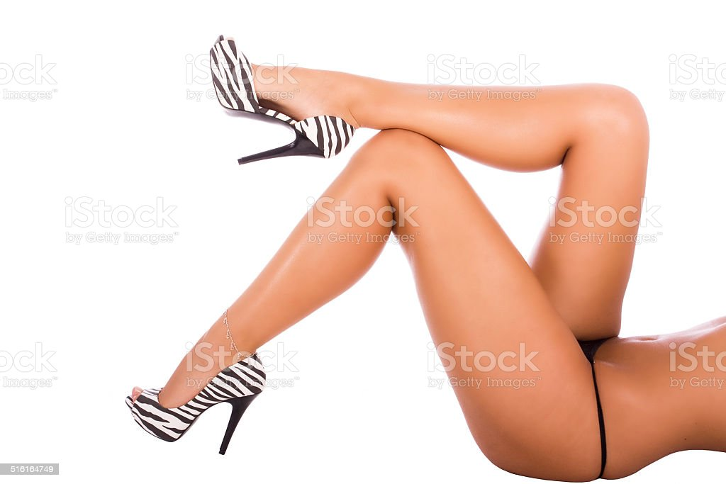 Beautiful, healthy and sexy feminine legs, isolated on white background stock photo