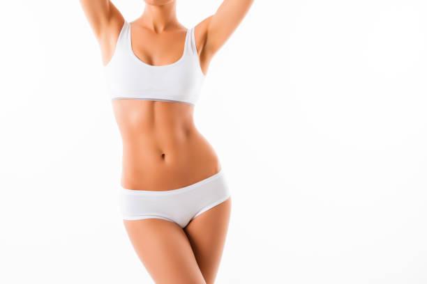 美しい健康的な白い背景のスリムな女性の身体にフィット ストックフォト