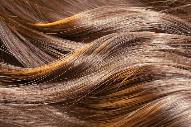 beautiful healthy shiny hair texture - curly brown hair stockfoto's en -beelden