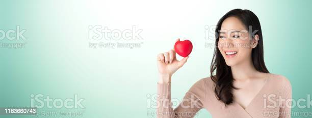 Beautiful healthy young asian woman holding and looking at red heart picture id1163660743?b=1&k=6&m=1163660743&s=612x612&h=dtf1lvtbdrhpwicnc5yax2txcg19gfa3qj2mzkdt1ty=