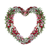 istock Beautiful heart shaped floral wedding arch with colorful roses flowers and tropical fern leaves, Valentine