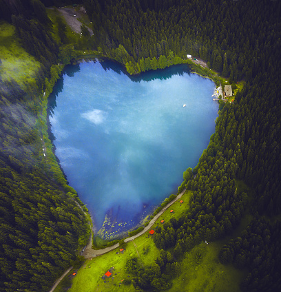 Aerial view of beautiful natural heart-shaped lake Karagol (Black lake) and forest in Savsat, Artvin, Turkey from bird eye view