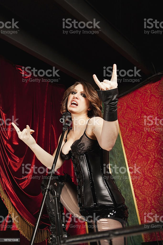 Beautiful Heavy Metal Singer Performing stock photo