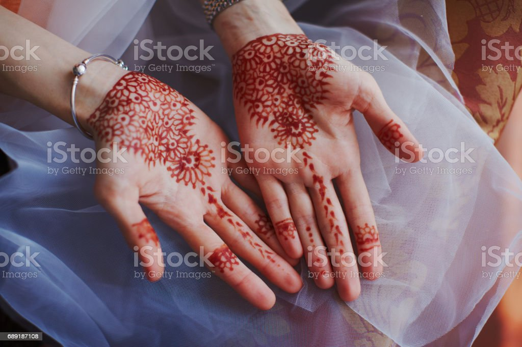 Beautiful henna patterns on hands of bride stock photo