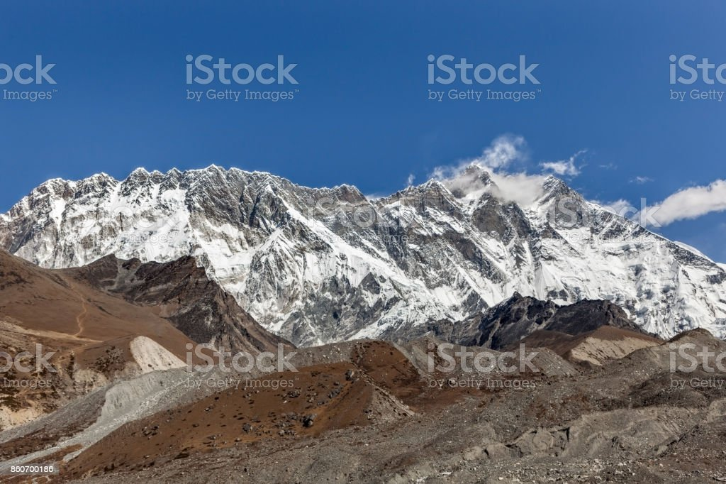Beautiful Himalayan mountain range on a bright sunny day. Lhotse and Nuptse mountains range view from Everest Base Camp Trek. Mountain range landscape in Sagarmatha National Park in the Nepal. stock photo