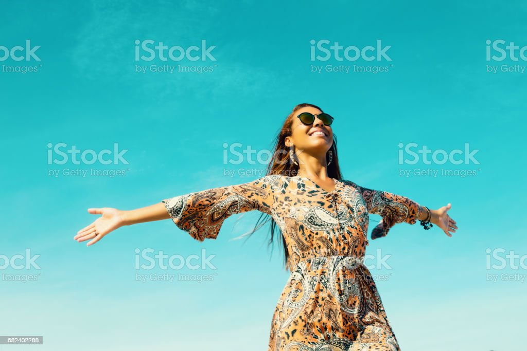 Beautiful hippie girl with copy space in blue sky outdoor in summer royalty-free stock photo