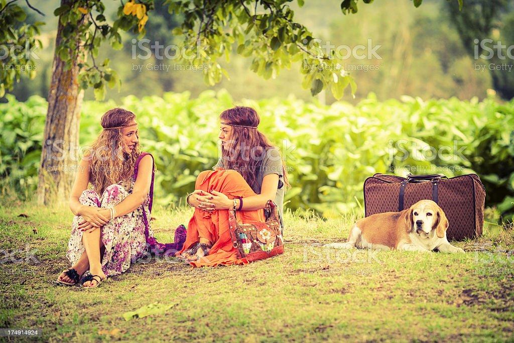 Beautiful hippie girls talking royalty-free stock photo
