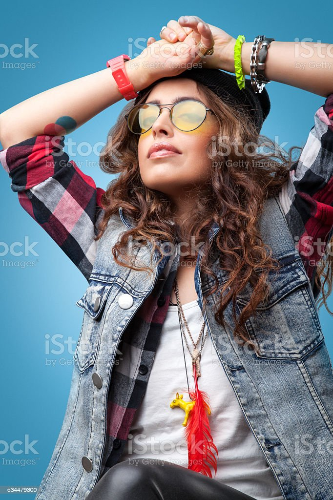151c4a97ad1 Beautiful hipster girl in black beanie hat with hands up. - Stock image .