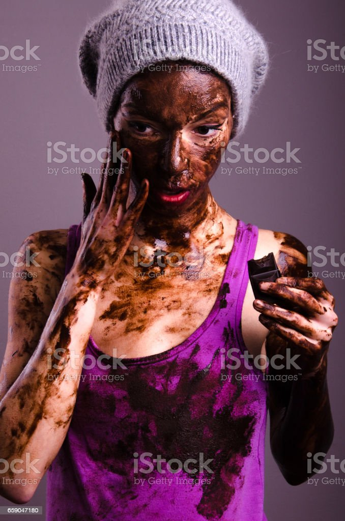 beautiful hipster girlfriend or wife dirty with chocolate in the studio stock photo