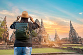 beautiful  hipster travel relaxing at Ayutthaya historical park thailand during sunset time