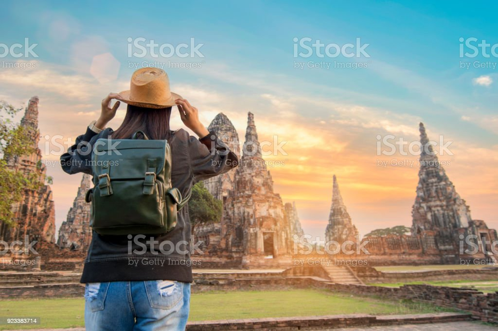 beautiful  hipster travel relaxing at Ayutthaya historical park thailand during sunset time stock photo