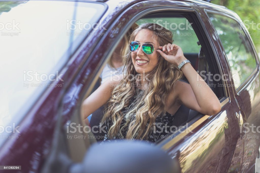 Beautiful hipster woman driving car stock photo