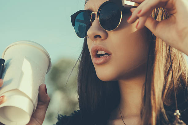 Beautiful hipster woman with cup of coffee stock photo