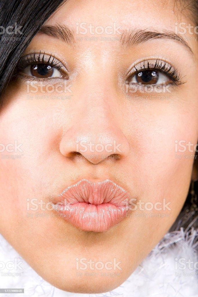 Beautiful Hispanic Girl with Kissing Lips royalty-free stock photo