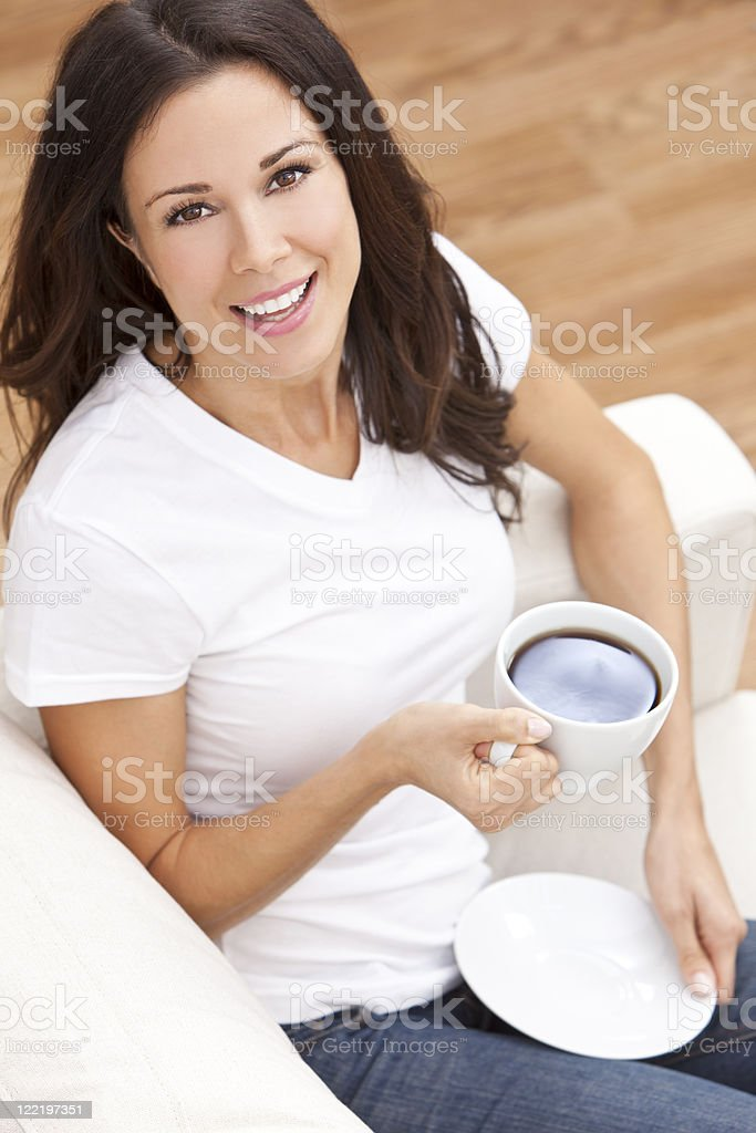 Beautiful Hispanic Latina Woman Drinking Tea or Coffee royalty-free stock photo