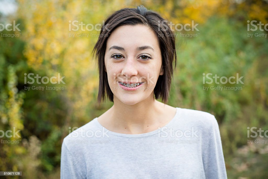 Beautiful Hispanic Teen Girl portrait with braces stock photo