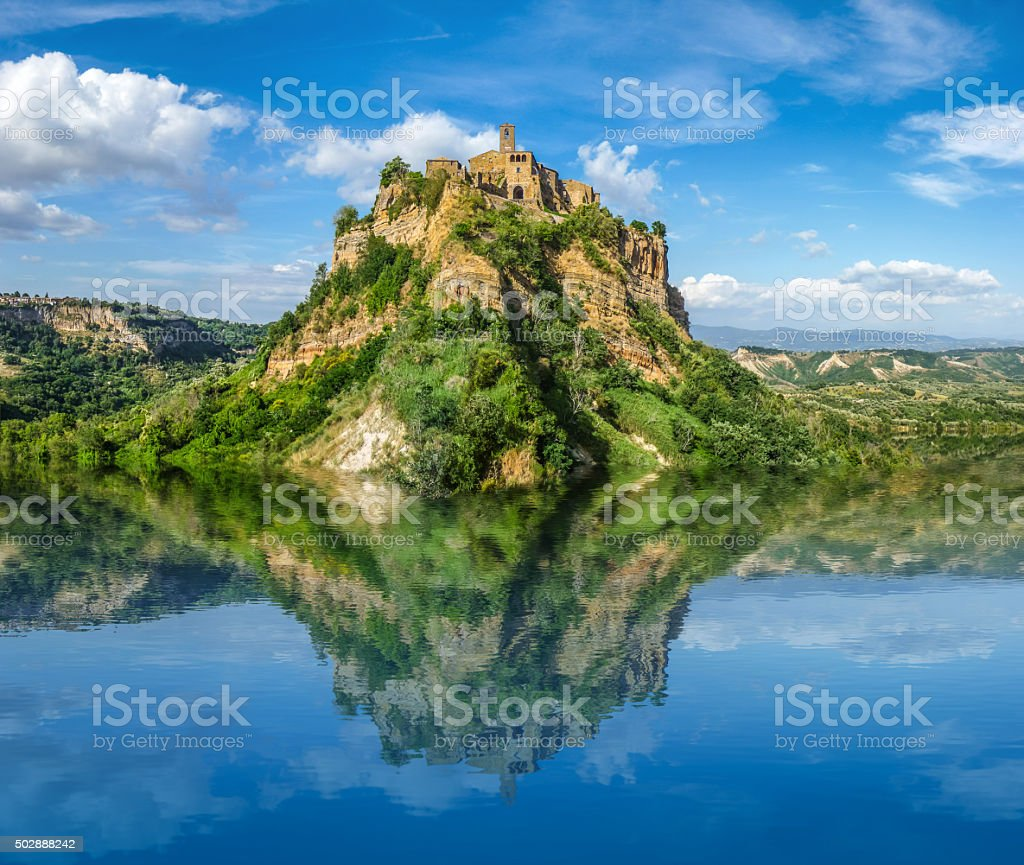 Beautiful historic castle on famous  rock with crystal clear lake stock photo