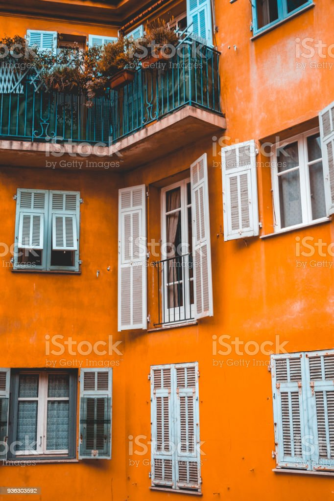 beautiful historical apartment facade with white old windows in the heart of nice, france stock photo